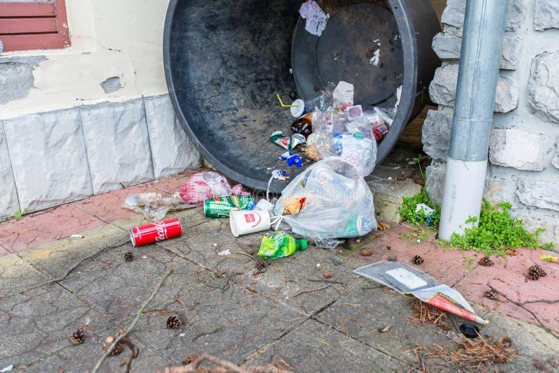 Human trash on street, conceptual human negligence image. Tusnad Bai, Romania- 22 June 2019: Human trash on street, conceptual human negligence image stock photos
