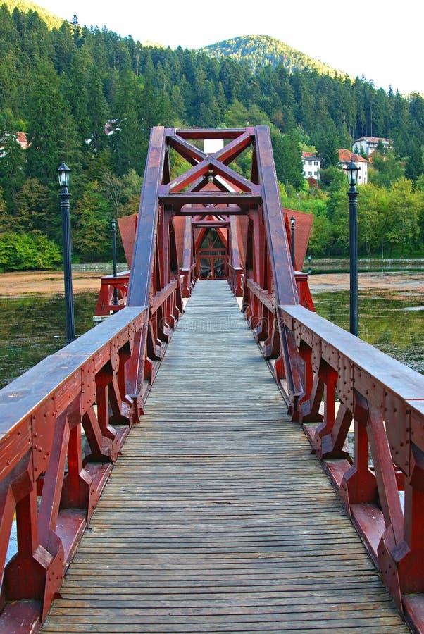 Tusnad spa: bridge to floating restaurant. On central ciucas lake stock image