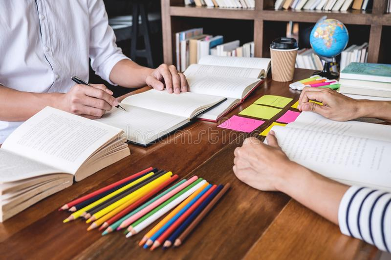 Tutor books with friends, Young students campus or classmates he. Lps friend catching up workbook and learning tutoring in classroom practice preparing exam to stock images