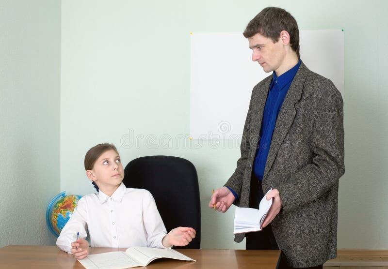 Download Tutor and schoolgirl stock photo. Image of sitting, brown - 9210880