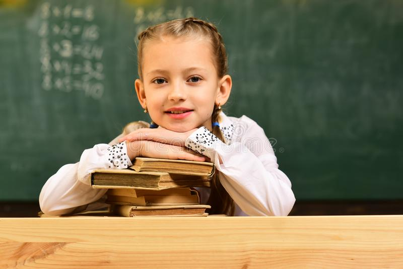 Tutor will require child to learn specific skill before advancing to level. University studying friends studying and. Reading books in classroom. Help with stock photos