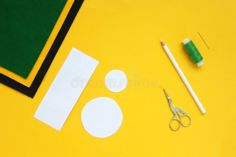 Tutorial how to sew felt leprechaun hat for St. Patrick`s day. Concept of DIY sewing art project. Step by step photo instruction. Top view, copy space. Step 1 royalty free stock photography