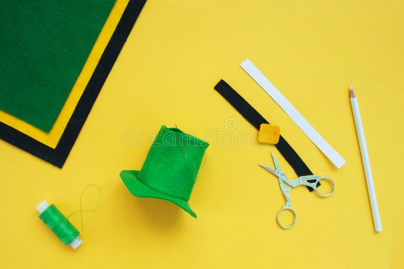 Tutorial how to sew felt leprechaun hat for St. Patrick`s day. Concept of DIY sewing art project. Step by step photo instruction. Top view, copy space. Step 5 stock photo