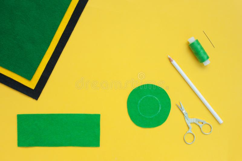 Tutorial how to sew felt leprechaun hat for St. Patrick`s day. Concept of DIY sewing art project. Step by step photo instruction. Top view, copy space. Step 2 royalty free stock photography