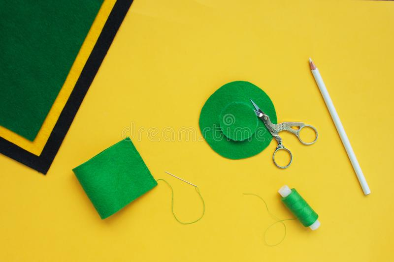 Tutorial how to sew felt leprechaun hat for St. Patrick`s day. Concept of DIY sewing art project. Step by step photo instruction. Top view, copy space. Step 3 royalty free stock photos