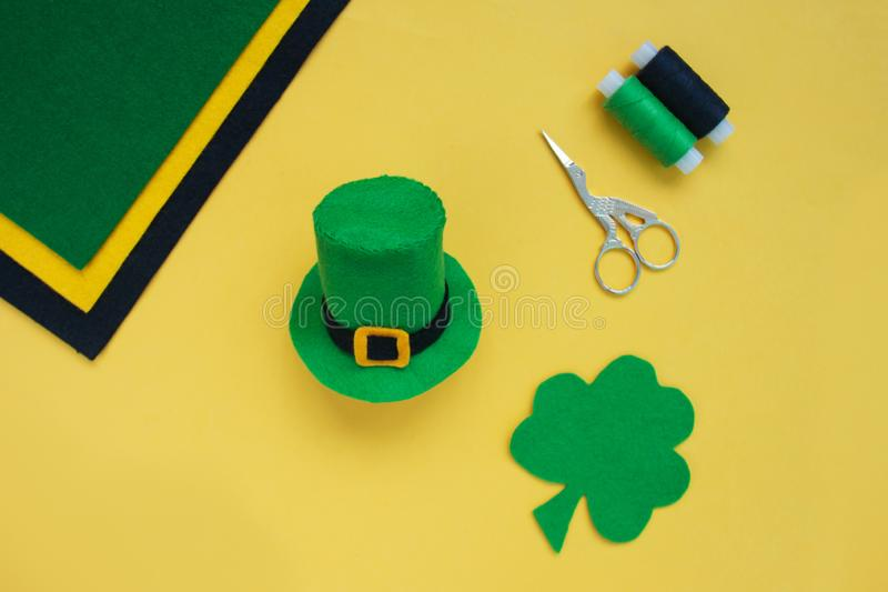 Tutorial how to sew felt leprechaun hat for St. Patrick`s day. Concept of DIY sewing art project. Step by step photo instruction. Top view, copy space. Step 7 stock photos
