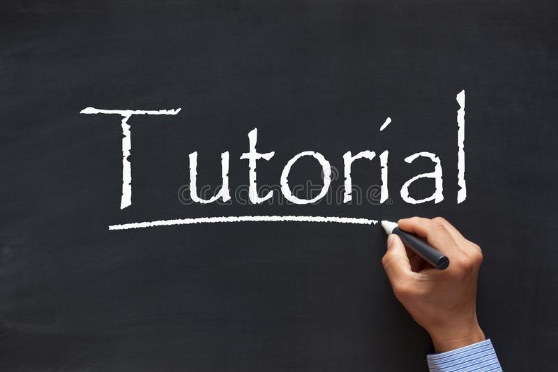 Tutorial written by hand stock image