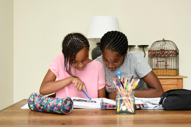 Tutoring at home. Teacher giving tutoring at home stock photography