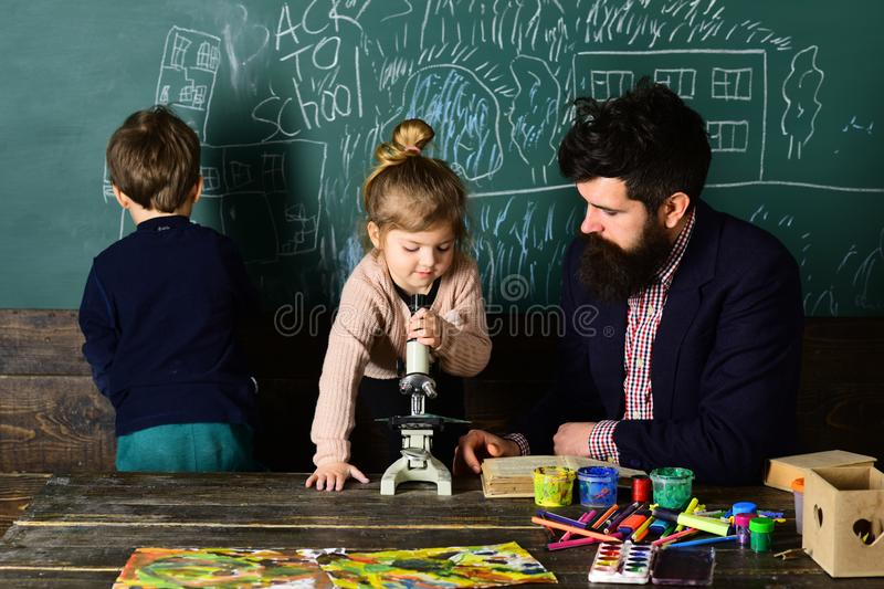 Tutors work closely with schools and teachers and may meet at the school. Learning at home. Kids often learn easier by royalty free stock photo