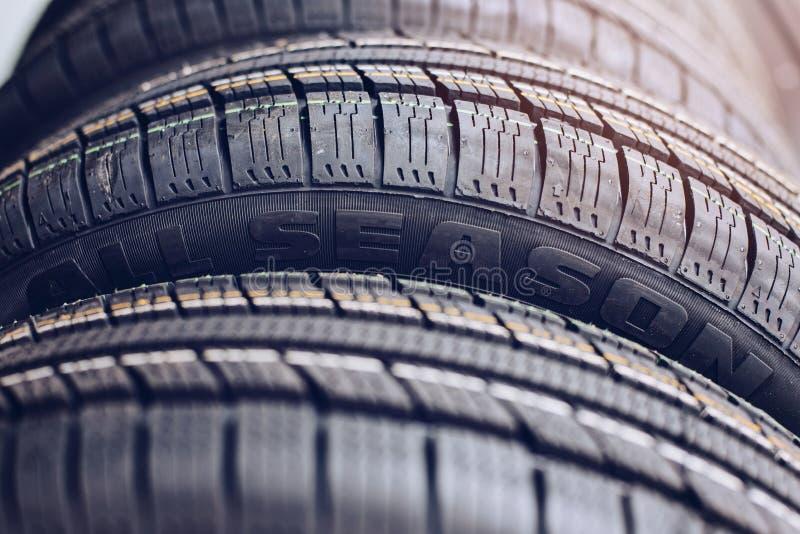 Tutte le gomme di automobile di stagione fotografia stock libera da diritti