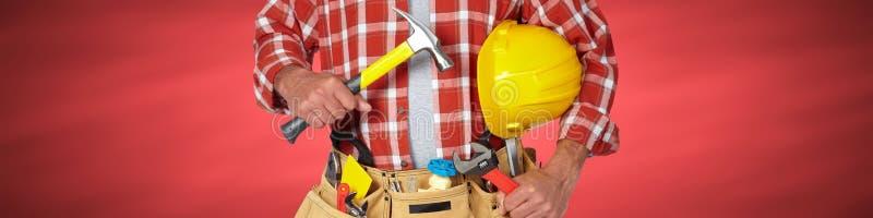 Tuttofare del costruttore con gli strumenti della costruzione fotografia stock