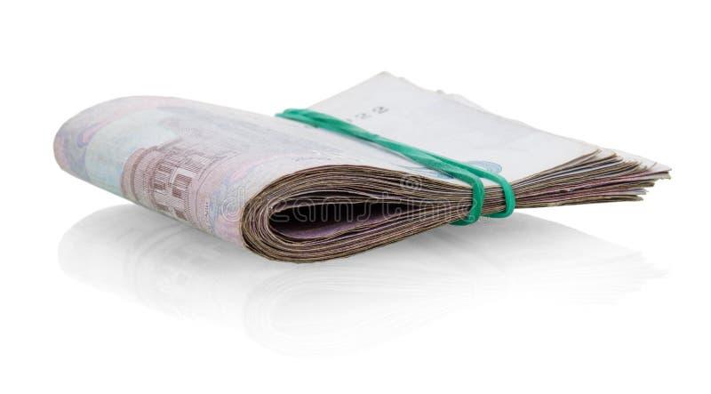 Tutu Ukrainian money fastened by rubber band on white. royalty free stock photo