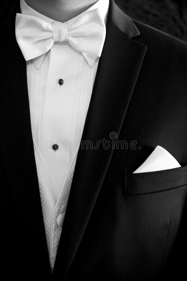 Tuxedo. A contrasty black and white picture of the top part of a tuxedo that was worn by the groom for his wedding royalty free stock photo