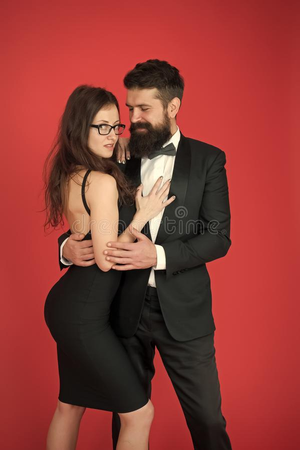 Tuxedo and dress. Formal couple. art experts of bearded man and woman. esthete. Romantic relationship. Couple in love on. Tuxedo and dress. Formal couple. art stock image