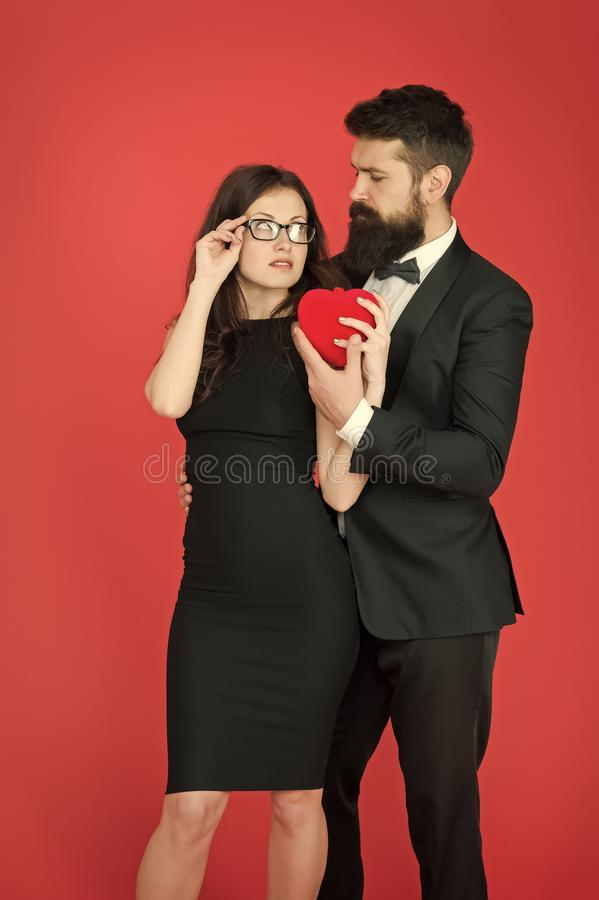 Tuxedo man and woman at formal party. valentines day heart. bearded businessman with lady. sexy couple in love. tuxedo royalty free stock photo