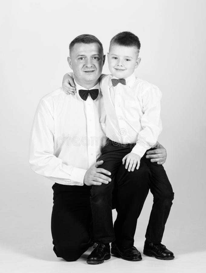 Tuxedo style. happy child with father. business meeting party. little boy with dad businessman. family day. esthete stock photo