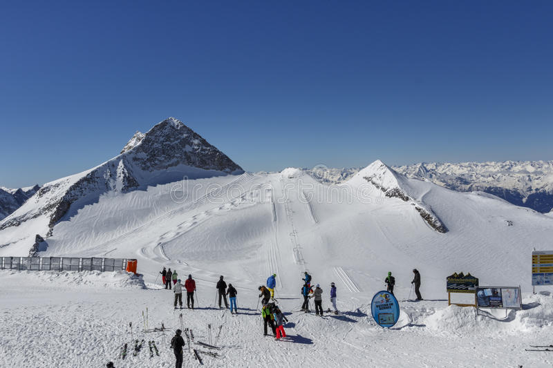Tuxer Ferner Glacier in Austria, 2015. Top of the Hintertuxer Glacier Tuxer Ferner in Tyrol, Austria with people preparing for downhill skiing stock photo