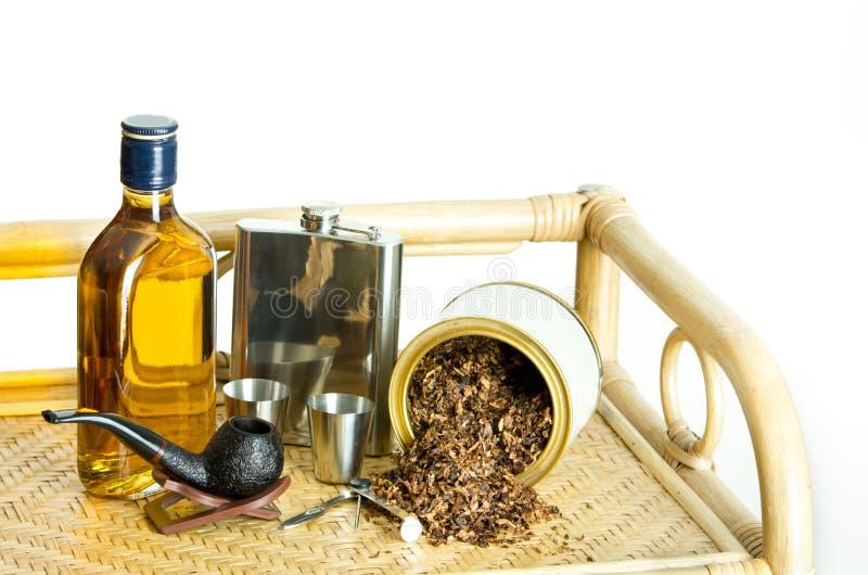 Tuyau et alcool de tabagisme photos libres de droits