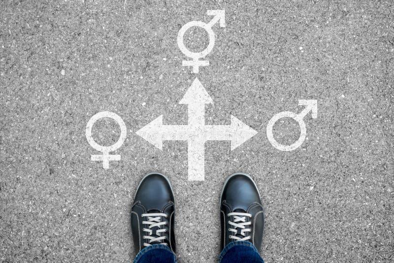 Tvärgata för tre vägar - man, kvinna eller transexual arkivbild