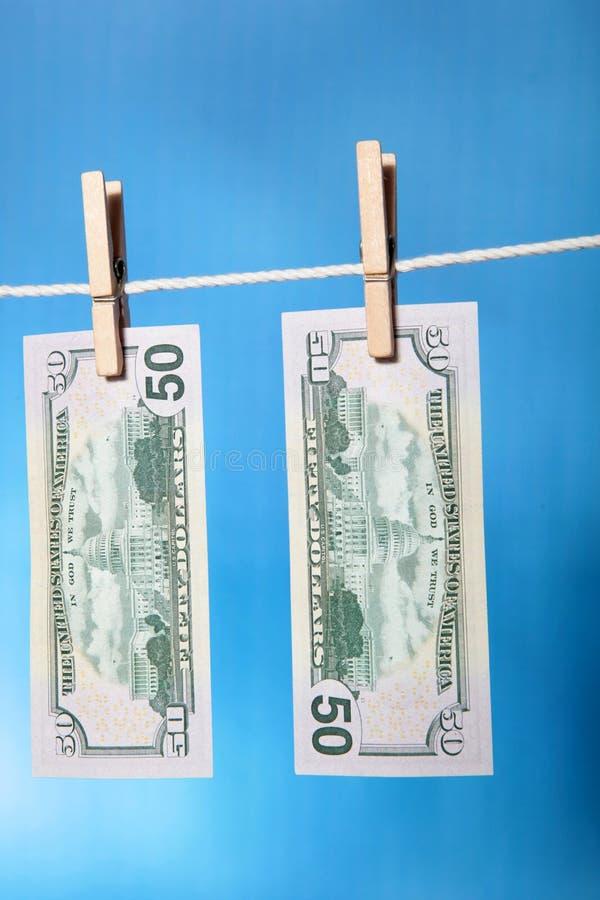 tvätta pengar royaltyfria bilder
