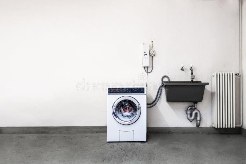 Tvättstuga för myntmaskin arkivfoto