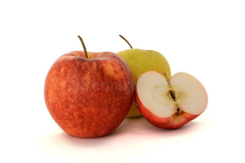 Två äpplen och halvan Apple royaltyfri bild