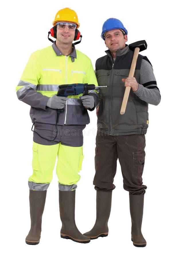 Två arbetare royaltyfri fotografi