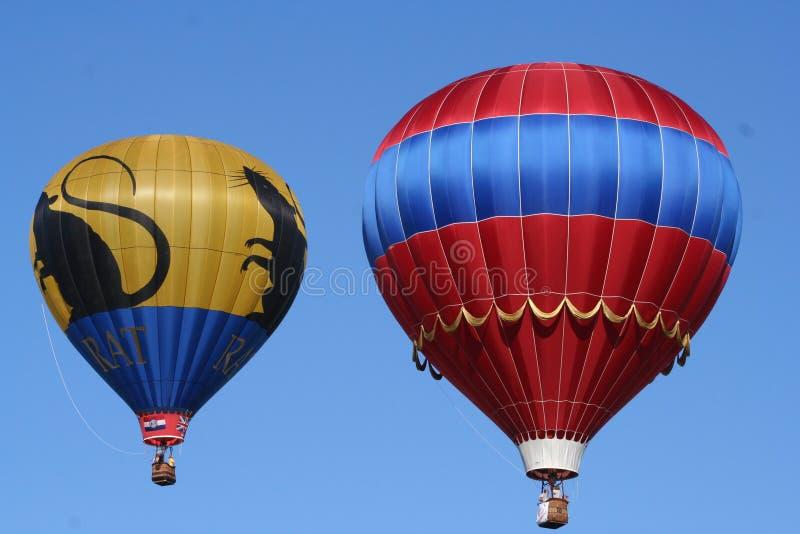 Två ballonger från det St Louis ballongloppet arkivbild