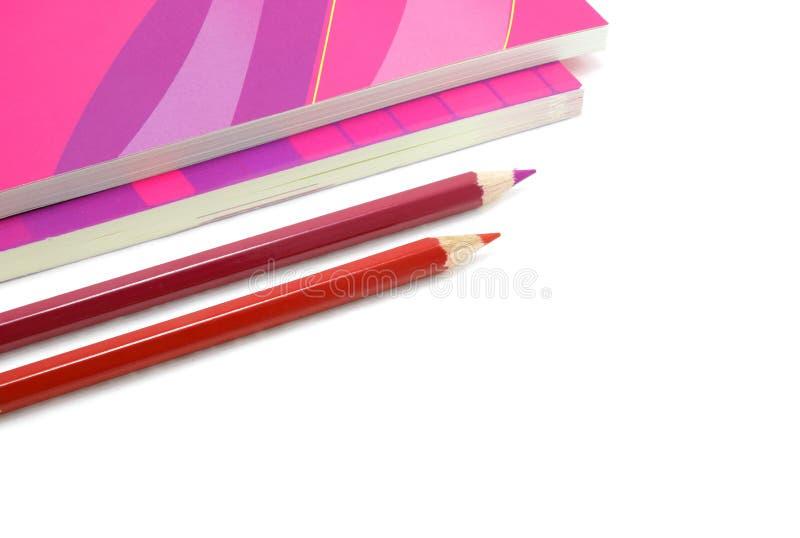 Två blyertspennor och bok två fotografering för bildbyråer