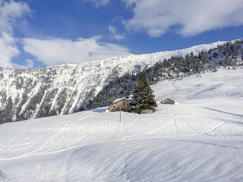 Två chalet i berget i courchevel arkivbilder