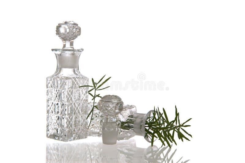 Två dekorativa glass flaskor med proppar royaltyfria foton