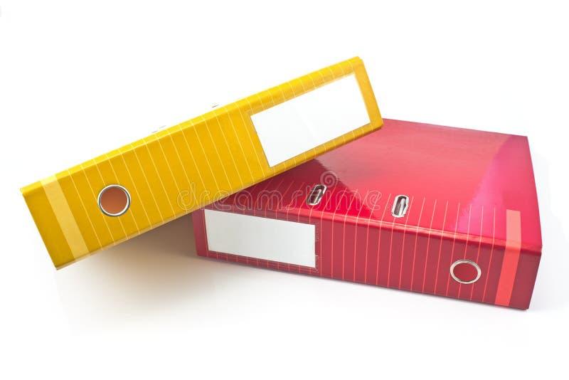 Två färgrika kontorsmappar arkivfoto