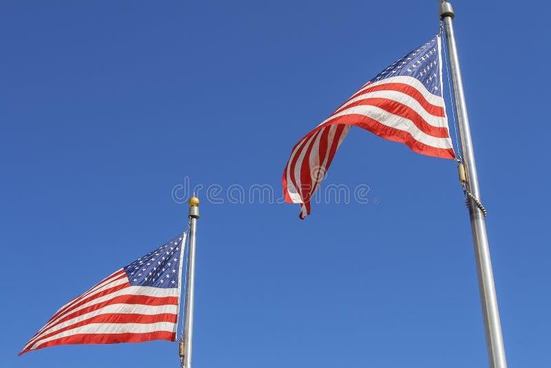 Två flaggor royaltyfria bilder