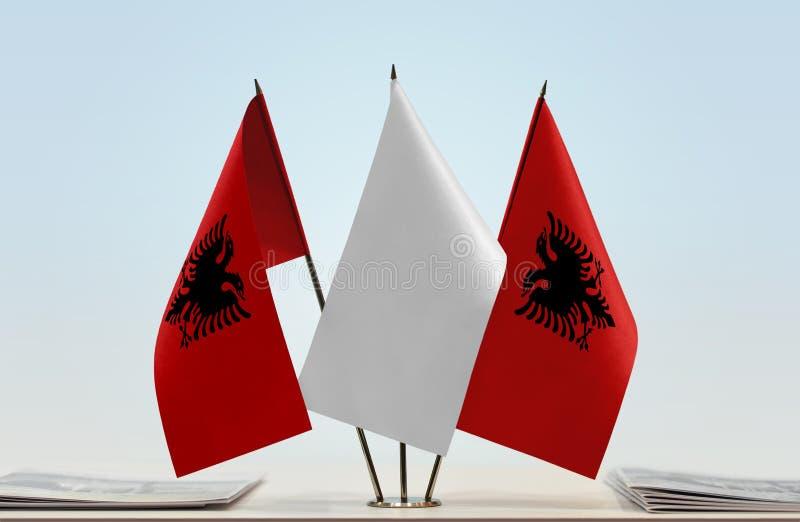 Två flaggor av Albanien royaltyfria foton