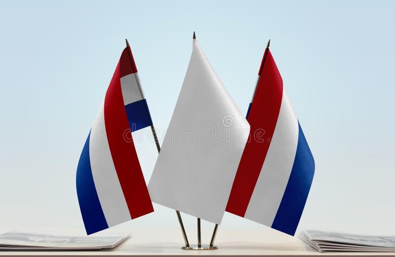 Två flaggor av Nederländerna royaltyfri foto