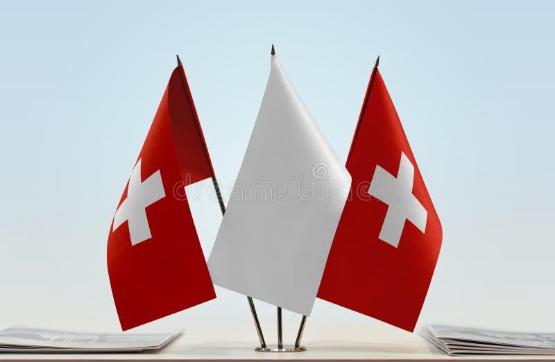 Två flaggor av Schweiz fotografering för bildbyråer