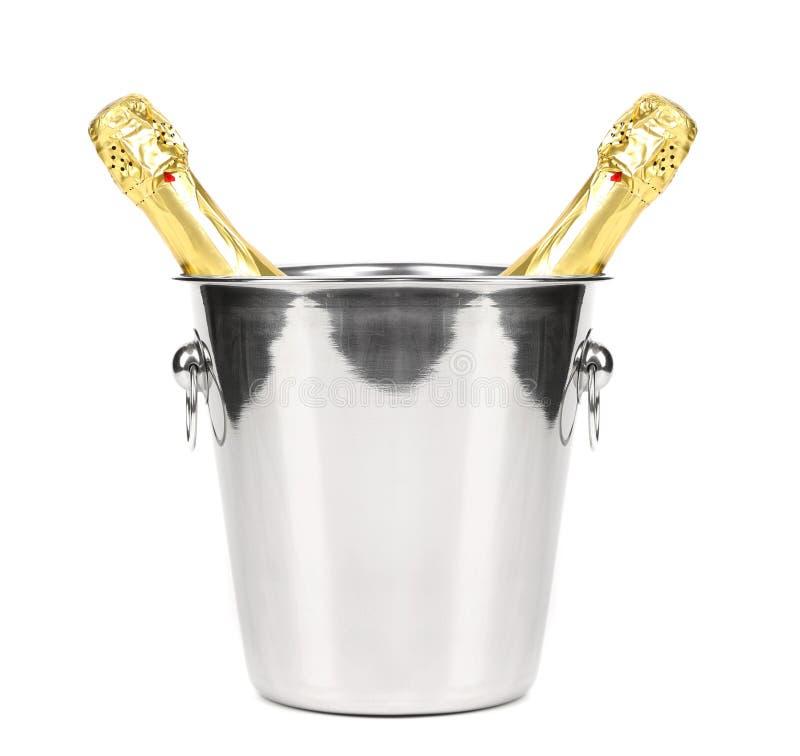 Två flaskor av champagne i kylare. royaltyfri foto