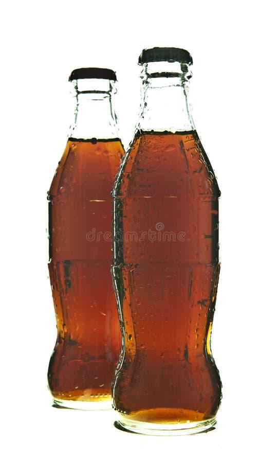 Två flaskor av colasodavatten royaltyfria foton