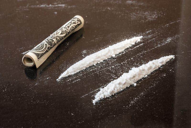 Två fodrar av kokain arkivfoton
