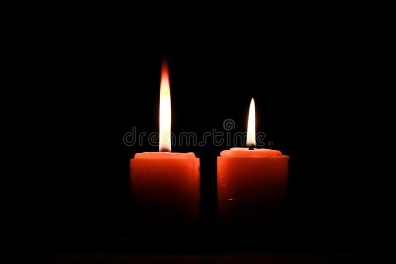 Två gånger brännande stearinljus arkivbild