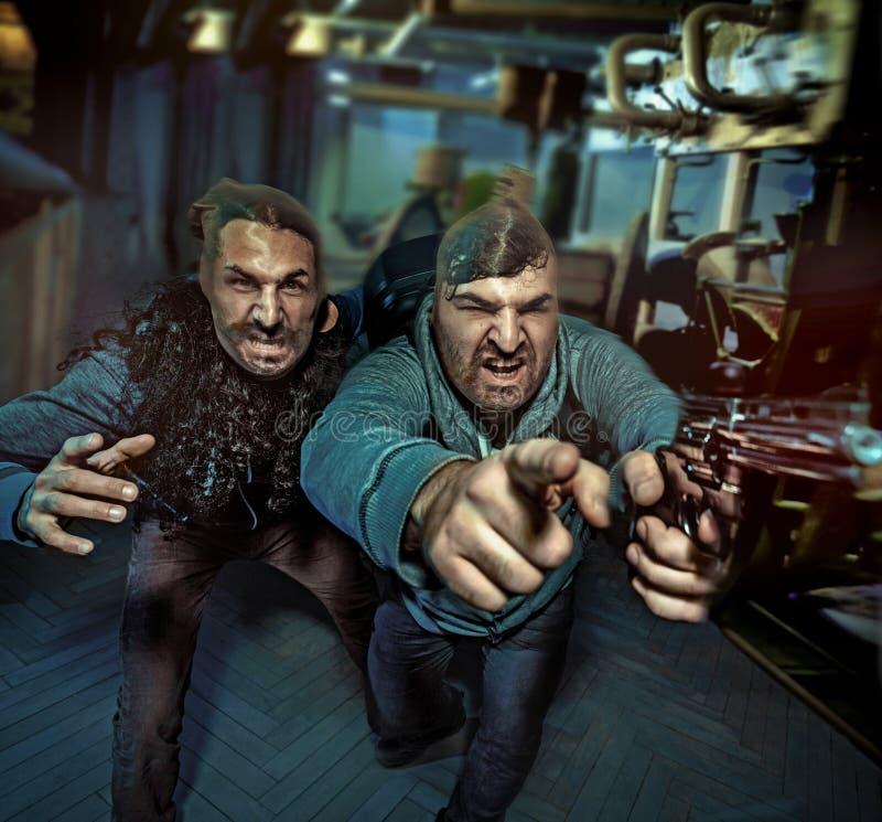 Två geekgrabbar som gör en röveri arkivfoto