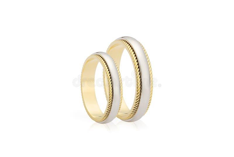 Två guldbröllopcirklar som isoleras på vit bakgrund royaltyfri foto