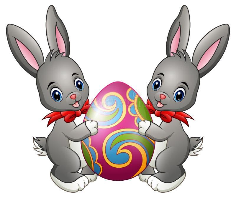 Två gulliga kaniner som rymmer påskägget på en vit bakgrund vektor illustrationer