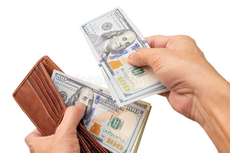 Två händer öppnar plånboken för att kontrollera dollarbeloppet för att förbereda sig för den nästa utgifter arkivbild