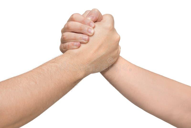 Två händer i en brottningarm Isolerad vitbakgrund arkivfoto