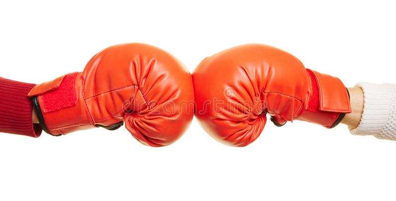 Två händer med röda boxninghandskar arkivbilder