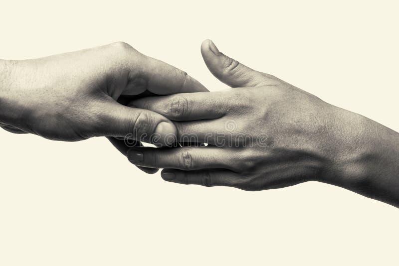 Två händer - omsorg fotografering för bildbyråer