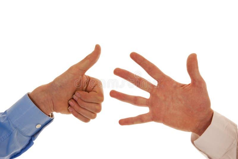 Två händer som figurerar nummer sex arkivbilder