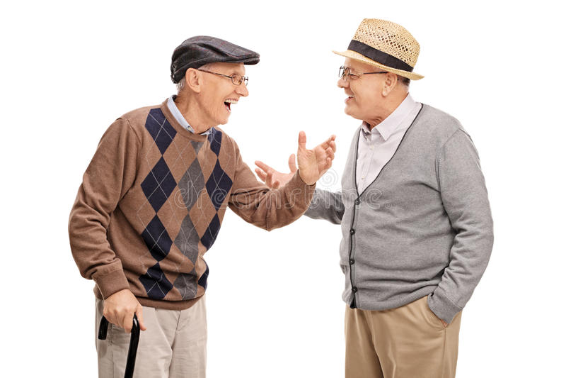 Två höga män som till varandra talar och skrattar royaltyfri foto