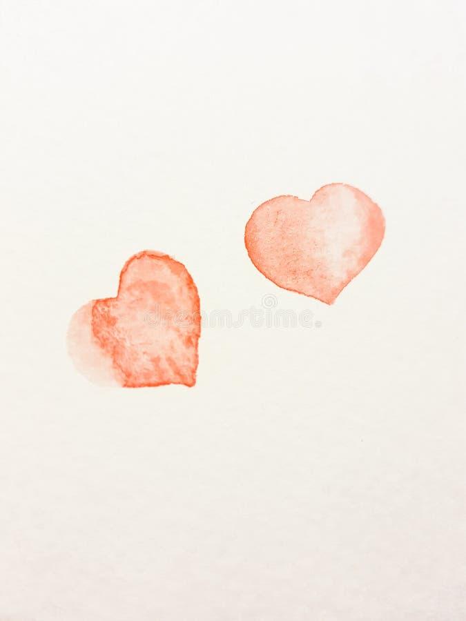 Två hjärtor som målas på valentin dagberöm arkivbild